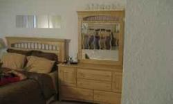 Solid wood bedroom set includes queen-size bed frame (without mattress), and dresser with glass mirror. Will also include 2 lamps with shades. All pieces are in very good condition; asking $450 for everything. Unfortunately, no delivery is available;
