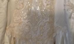 Gorgeous wedding dress, worn 2x. Has been altered on the top for broader shoulders. Beautiful lace, beads, sequins, and a bow on the back, neck and back are V shaped. Long train that has 7 button/eyelet holders that are hidden underneath to shorten the