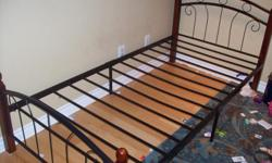 Solid wood/MetalBed frame for sale in good condition.