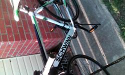 Black white and green 7speed 29 inc. Bike need a tube for one tire but everything else is fine ride great it fast
