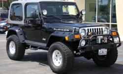 RUBICON! Only 79,xxx miles, front winch, 4 spotlights, side steps, Kc Foglights, tube rock rails, full sized spare, chrome grill, towing package, hard top, v6 engine, manual transmission, tinted windows, A/C and heat, CD and stereo, rear seat, power