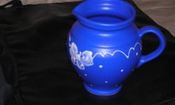 blue hand made pitcner