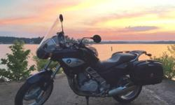 """BMW F650CS """"Scarver""""- 9,100 miles - Like new condition, need's nothing - Metallic Gray - Good tires/brakes - dealer serviced and ready to ride. Includes oversized windscreen and lockable/quick release Givi side bags ($500 value)."""