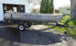 14 ft. Alumacraft boat and trailerwith 15 hp Johnson motor, includes: trolling motor and battery, depth finder, anchor with hand anchor mate, 2 swivel seats and spare tire. Excellent condition. Call, if no answerleave a