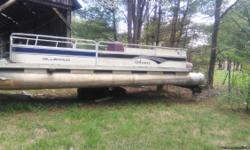Pontoon boat with 75 mariner engine with stainless prop. Needs a good cleaning and a little TLC. Moving out of town and its for sale. Big in size and would make good boat with just a little care. Has newer model engine and newer year side panels.title in