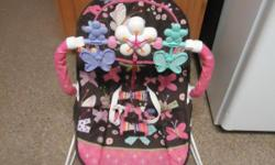 Soothe and entertain your littlest one in this Comfy Time Butterflies Bouncer from Fisher Price. Two vibration levels offer peaceful movement while dangling plastic butterflies & flowers on the removable toy bar keep your baby entertained. Non-skid feet