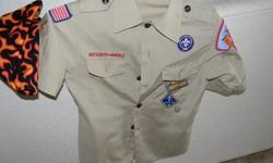 Official Centennial Boy Scout Shirt S/S cotton. Size 10-12 (M) Already has a lot of the required patches adhered to the shirt. Also comes with the flaming neckerchief. Shirt in excellent condition.