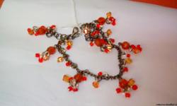 Nice hand-made. With swarovski beads.