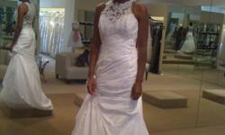 White size 8 wedding dress never worn, tags still attached. Asking $500 but willing to come down off the price if the offer is reasonable.