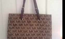 I have a Michael Kors handbag that is in brand new condition for sale. It is very clean, no rips and material is not worn out. Retail price was 228.00 and I am willing to sell for 175.00.