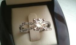 ASKING PRICE : $6500 OR BEST OFFER (REDUCED FROM 7500, MUST SELL) RETAILS FOR $10,000 SO THIS IS DEFINITELY MY LOSS BUT I HAVE TO SELL IT THIS RING IS BRAND NEW, AND HAS NEVER BEEN WORN DETAILS: TOTAL DIAMOND WEIGHT : 2.08 CT CENTER DIAMOND: 1.66 CARAT