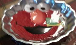I have an Elmo cake pan that is new, NEVER used. $8 FIRM. Only those serious need call --. No emails please.