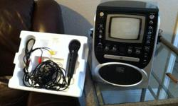 Barnard new karaoke machine that has never been used. Includes microphone, wires, and a built in set of songs.