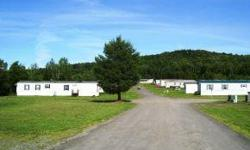 There are 20 sites in this mobile home park with room for expansion. The town water and sewer are paid by tenants on a separate billing system. Lawn and driveway maintenance are performed by leaseholders. Land stretches up the hillside offering a nice