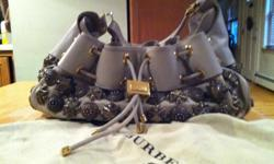 """This is an authentic GRAY LEATHER handbag; on exterior arepewter studs, there is a leather drawstring with a gold 1inx2in press closure. The closure reads """"burberry established 1856"""". The handbag was purchased in Italy at their retail"""