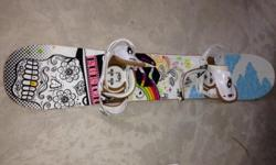 Burton Gtwin. Women's twin tip board. 148. Good condition and lightly used minus small rock chip on one of the edges. Cute design. Comes with Lexa bindings that have toe strap. Original value of board plus bindings was around $500.