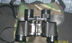 for sale Bushnell Binoculars, zoom Ensiga 7-15x35 field at 7x 300' at 1000 yds. fully coated optics. made in japan J B 133. and number Z5007, used but in good condition and works, asking $25 dollars, call. 608-372-0713 can ship in you need me
