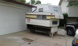 8 foot slide-in camper sleeper, good condition, table that folds into a bed. Camper Jacks included.