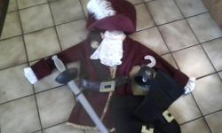 Disney Store - Captian Hook Costume -Boys Size XS (fit my son when he was 6 yrs old) Velvet Jacket, Rubber Props Includes: Jacket, Hat Belt, Shirt Ruffles, Hook Sword and Boot Covers Purchased from the Disney Store Paid $60. Worn once Great Detail Like