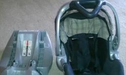 New car seat with base. Neutral colors for baby boy or girl. Also has a plastic case for storage.