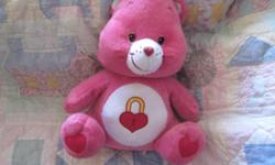 *~* Sweet Care Bear She is 12 inches tall. She might need a light cleaning but over all she is good.Her nose is a little scuffed up and her eyes are good. She measures about 12inches tall. Sweet little bear. Heart some of the printing has come off. Sweet