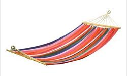 The perfect way to unwind at the end of a busy day or enjoy a lazy afternoon watching the clouds float across the sky. Colorful wooven hammock lets you really stretch out for maximum relaxation. Wooden stretcher bars and heavy duty hanging loops. Max. wt.