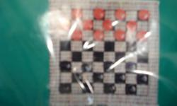 BRAND NEW HARDLY USED CHECKER RUG GAME