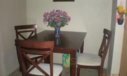 """Cherry wood dinning room table and 4 chairs. MUST sell as I got a new one for X-Mass. Excellant condition Asking $100.00 Table is 30"""" in height -- 35"""" in width and is 47"""" long"""