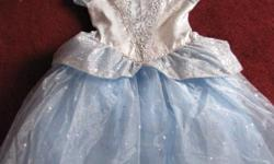This is an original Cinderella Disney Princess dress. Size medium (7-8) Worn once. Purchased at Walt DisneyWorld. Excellent condition. Will throw in matching tiera and wand.