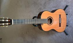 Ibanez 6 string classical guitar, with guitar stand, purchased new 6 months ago
