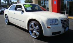 The Chrysler 300 has been redefining class and luxury for the last few years and this particular 300 will show you why! This spacious vehicle is loaded with power sliding moonroof, Bluetooth, power windows and locks, premium chrome wheels, mp3 reader,