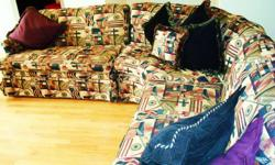 Beautiful Antique sectional couch for sale. This is a beautiful couch that was reupholstered a couple of years ago to a more modern design (see photos). There are many colors in the fabric which makes this couch easy to match any color scheme and