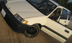 This is my Honda Civic Wagon. Drive it Everyday. It is Tan/Creme $3500 5 speed Manual. Car has 195714 miles, The motor (D-15-B) has 30,000 miles. This car will last. XXR Rims. (15 in) Personal short shifter. Camber Kit. All Four mudflaps. New Clutch.