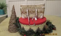 """Don't delay - start your Christmas shopping today! Check out this very gently used authentic """"Coach"""" shoulder length designer purse. Beigeand cream in color withthe signature """"C"""" design, this little jewel has a"""