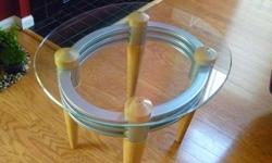 Coffee Table with two side tables. Oval shaped glass center Coffee table with wooden legs and two similarly matched side tables also with same oval glass and wooden legs. Dimensions as below: Center Table: 4? x 3? oval (glass) Side Tables: 2?4? x 2? oval