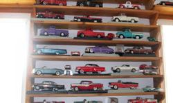 They are scale 18 diecast. There are 1930,1940,1950,and some 1960's. Buick,Chevrolet,Fords,and Chrysler. Approximately 100 collectable vehicles,(Most boxes are included). Not sold as individuals they are being sold as a set.