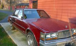 Complete Doghouse for a 76-78 Cadillac Seville, complete core support, innerfenders, front bumperts, burguny in color, no rust. Solid