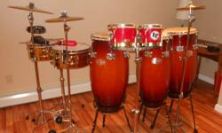 complete percussion set-up. 3 gon bops congas with top of the line cowskins,lp fiberglass bongos,lp matador brass timbales,3 cymbals, blocks,cowbells,maracas,tambourines,shakers,etc. this set is for the serious player.i will even throw in conga bags,