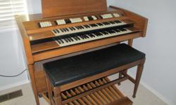 Older model Conn double keyboard organ with pedal bass and bench. Not perfect but plays well and looks great. It is yours free if you take it away.