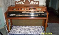 Good at electronics? You may want this vintage Conn electronic home organ with a lovely cherry wood cabinet. With a little knowledge of electronics you could have a lovely instrument. Only $50.00 cash and carry or free to a charitable