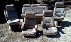 Two captianchairs with pedistool, one chair has small tear at seam that can be repaired very easy. Two captian chairs without pedistool, one arm has small tear and bench seat with pedistool that folds out into bed. All are very clean in