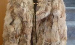 Gorgeous Coyote Fur Jacket with matching purse....hardly worn...looks like new...purchased at Joskes Fur Gallery Downtown for 800.00....Asking 200.00..rare!!!
