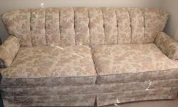 Beautifulchannel back sofa in muted floral pattern. Excellent condition. Rarely used. Measures 76 inches long X 34 inches deep and 29 inches height of back. Includes matching pillow. Solid hardwood frame. Moving