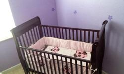 3 in 1 Delta Love Crib and Changing table. Cherry wood color in excellent condition. Includes: - Crib - Mattress - Bedding includes: Crib Quilt ,(1) Crib Bumper (1)Fitted Sheet,(1)Crib Skirt,(1) - Changing table Please call or text me with any questions