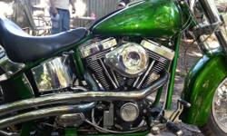 2002 custom harley soft tail with 96inch ss motor. the motor has less then 2000 miles on it.this is a beautiful bike must see to appriciate!!