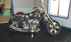 custom 2001 chopper with 100 inch rev tech engine and tranny three dmebnsional flames were created by cutting flames from existing tins and welding to these tins picture really don't do this head turner justice .It won first place in chopper class at