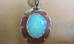Sterling silver and Australian opal handcut and set locally in USA and one of a kind by local designer. Pendant has a 18mmx14mm gem stone of gorgeous colors set in a sterling mount on a sterling hanger with a very nice 18in sterling chain. Pendant is