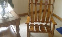 Brand new custom made child's log rocking chair. Chair is made out of oak and birch with birch accents. See www.woodworksbysullivan.com for more products
