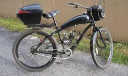 29in. genisis onex motorized bicycle, 49cc front and rear storage, headlight, tailight, custom made gas tank, must see in person to appreciate 750.obo --