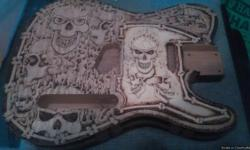 Over 50 hours of wood burning went into this guitar body, totally covered front back and side of the body of the guitar has been done, truly one of a kind guitar body.